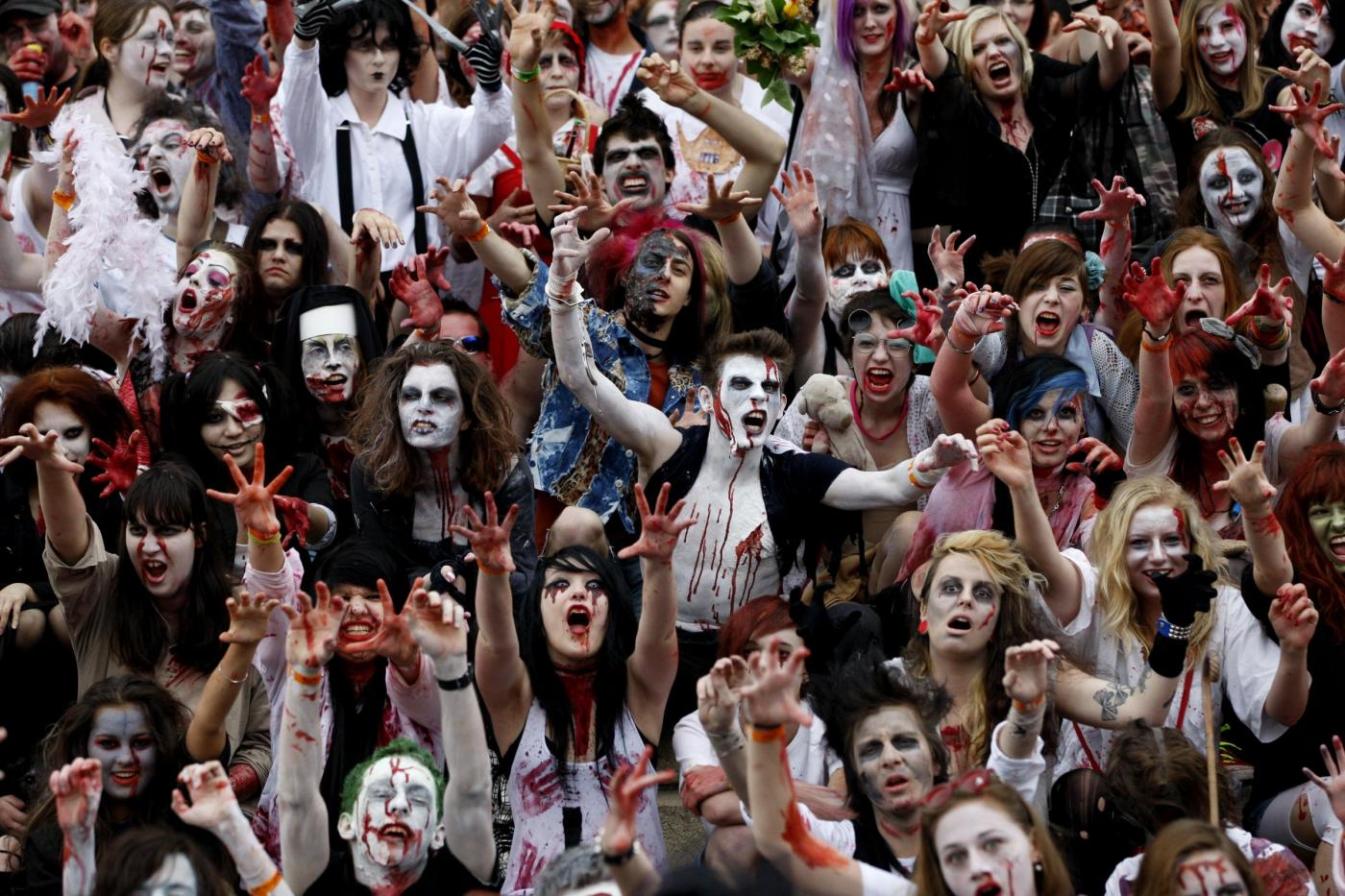 Several hundreds of participants dressed and made up as zombies pose for photo after a traditional Zombie Walk in Prague, Czech Republic, Saturday, May 5, 2012. (AP Photo/Petr David Josek)